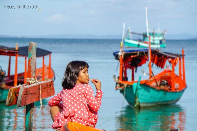 Cambodian girl enjoying the morning at the beach of Koh Rong